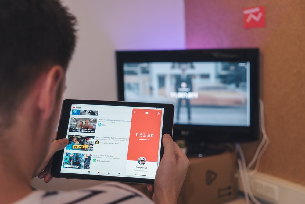 : a person using YouTube on a tablet.
